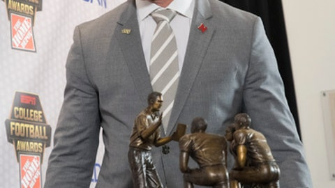 Central Florida coach Scott Frost walks off the stage after posing with the Coach of the Year Award during the College Football Awards show at the College Football Hall of Fame, Thursday, Dec. 7, 2017, in Atlanta.(AP Photo/John Amis)