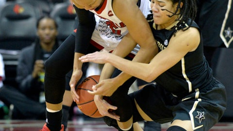 Vanderbilt guard Chelsie Hall (2), right, battles Louisville guard Asia Durr (25) for the ball during the first half of an NCAA college basketball game, Thursday, Dec. 7, 2017, in Louisville, Ky. (AP Photo/Timothy D. Easley)