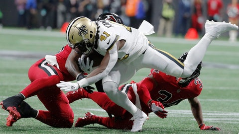 Atlanta Falcons middle linebacker Deion Jones (45) hits New Orleans Saints running back Alvin Kamara (41) during the first half of an NFL football game, Thursday, Dec. 7, 2017, in Atlanta. (AP Photo/David Goldman)
