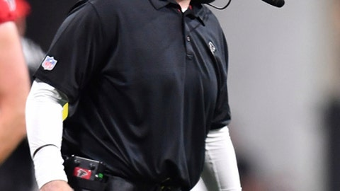 Atlanta Falcons head coach Dan Quinn speaks to players during the first half of an NFL football game against the New Orleans Saints, Thursday, Dec. 7, 2017, in Atlanta. (AP Photo/Danny Karnik)
