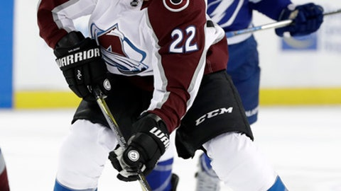 Colorado Avalanche center Colin Wilson (22) loses control of the puck after getting past Tampa Bay Lightning center Cedric Paquette (13) during the first period of an NHL hockey game Thursday, Dec. 7, 2017, in Tampa, Fla. (AP Photo/Chris O'Meara)