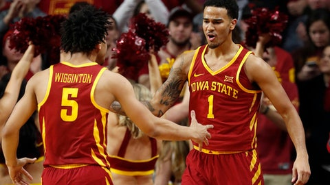 Iowa State guard Nick Weiler-Babb (1) celebrates with teammate Lindell Wigginton (5) after making a basket during the second half of an NCAA college basketball game against Iowa on Thursday, Dec. 7, 2017, in Ames, Iowa. (AP Photo/Charlie Neibergall)