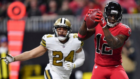 Atlanta Falcons wide receiver Mohamed Sanu (12) makes a touchdown catch against New Orleans Saints cornerback Sterling Moore (24) during the second half of an NFL football game, Thursday, Dec. 7, 2017, in Atlanta. (AP Photo/Danny Karnik)