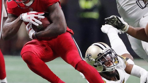 New Orleans Saints free safety Vonn Bell (48) Atlanta Falcons running back Tevin Coleman (26) runs past during the second half of an NFL football game, Thursday, Dec. 7, 2017, in Atlanta. (AP Photo/David Goldman)