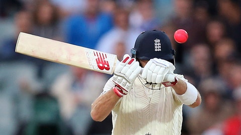 In this Tuesday, Dec. 5, 2017, file photo, England's Joe Root swings at a high delivery from Australia's Pat Cummins during the fourth day of their Ashes cricket test match in Adelaide, Australia. (AP Photo/Rick Rycroft, File)