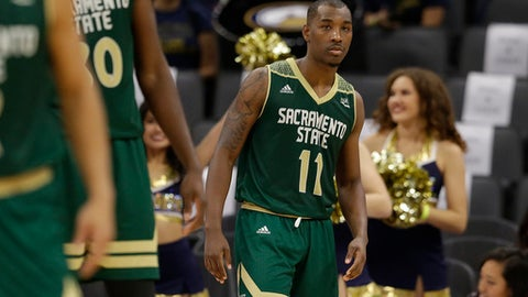 In this photo taken Tuesday, Nov. 21, 2017, Sacramento State guard Kevin Hicks, right, is seen during a timeout in an NCAA college basketball game against UC Davis in Sacramento, Calif. Hicks broke down in his first trip back to the 9th Ward of New Orleans since Hurricane Katrina uprooted his family. The bones are what hit Hicks. Not the house that was destroyed, not the devastation still apparent three years later, not the clothes wadded up in the corner of what was once his bedroom. No, the bones of the family dog scattered in the yard are what did it. (AP Photo/Rich Pedroncelli)