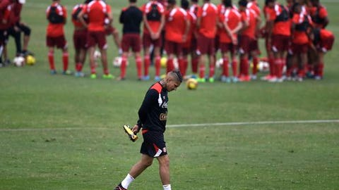 FILE- In this Tuesday, Oct. 3, 2017 file photo, Peru's Paolo Guerrero arrives for a national soccer team practice session in Lima, Peru. FIFA banned Peru captain Paolo Guerrero for one year after a positive test for cocaine, on Friday, Dec. 8, 2017, forcing the striker to miss the World Cup. (AP Photo/Martin Mejia, File)