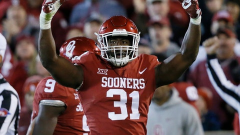 FILE - In this Oct. 28, 2017, file photo, Oklahoma defensive end Ogbonnia Okoronkwo (31) gestures to the crowd in the third quarter of an NCAA college football game against Texas Tech, in Norman, Okla. Okoronkwo was selected to the AP All-Conference Big 12 team announced Friday, Dec. 8, 2017. (AP Photo/Sue Ogrocki, File)