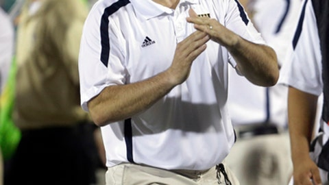 Florida International head coach Mario Cristobal signals a time out during the second half of an NCAA college football game against Louisville in Miami, Saturday, Sept. 22, 2012. Louisville defeated FIU 28-21.(AP Photo/Lynne Sladky)