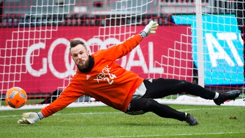 Seattle Sounders goalkeeper Stefan Frei (24) dives for the ball during practice ahead of the MLS Cup soccer final against Toronto FC, in Toronto, Friday, Dec. 8, 2017. (Nathan Denette/The Canadian Press via AP)