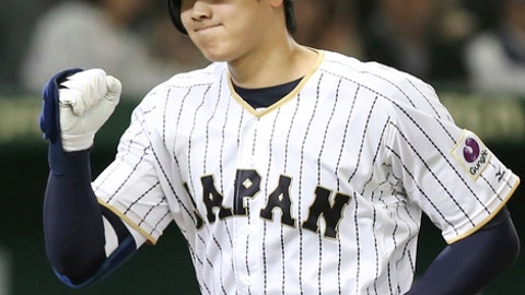 FILE - In this Nov. 12, 2016, file photo, Japan's designated hitter Shohei Ohtani reacts after hitting a solo home run off Netherlands' starter Jair Jurrjens in the fifth inning of their international exhibition series baseball game at Tokyo Dome in Tokyo. Japanese star Shohei Ohtani is bringing his arm and bat to the Los Angeles Angels, pairing him with two-time MVP Mike Trout. Ohtani's agent put out a statement Friday, Dec. 8, 2017, saying the prized two-way player had decided to sign with the Angels, a surprise winner over Seattle, Texas and several other teams. (AP Photo/Koji Sasahara, File)