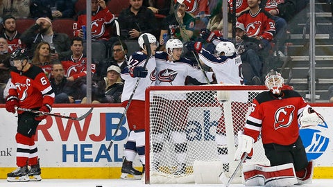 New Jersey Devils goalie Cory Schneider reacts after giving up a goal to Columbus Blue Jackets center Lukas Sedlak during the second period of an NHL hockey game, Friday, Dec. 8, 2017, in Newark, N.J. (AP Photo/Adam Hunger)