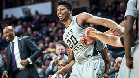 Wake Forest forward Terrence Thompson (20) celebrates after guard Aaron Spivey scored a basket and was fouled late in the second half against Army during an NCAA college basketball game Friday, Dec. 8, 2017, in Winston-Salem, N.C. (Andrew Dye/The Winston-Salem Journal via AP)