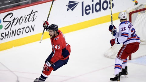 Washington Capitals right wing Tom Wilson (43) celebrates his goal next to New York Rangers defenseman Kevin Shattenkirk (22) during the third period of an NHL hockey game Friday, Dec. 8, 2017, in Washington. The Capitals won 4-2. (AP Photo/Nick Wass)