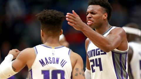 NEW ORLEANS, LA - DECEMBER 08:  Buddy Hield #24 of the Sacramento Kings reats with Frank Mason III #10 of the Sacramento Kings after defeating the New Orleans Pelicans during a NBA game at the Smoothie King Center on December 8, 2017 in New Orleans, Louisiana. the Sacramento Kings won the game in overtime 116 -109.  NOTE TO USER: User expressly acknowledges and agrees that, by downloading and or using this photograph, User is consenting to the terms and conditions of the Getty Images License Agreement.  (Photo by Sean Gardner/Getty Images)