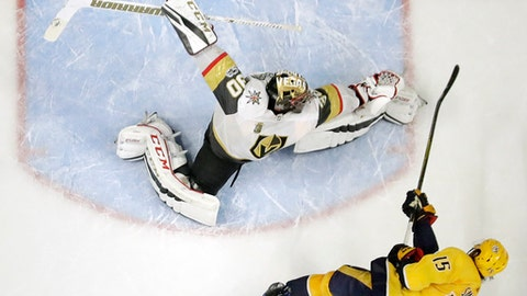 A shot by Nashville Predators right wing Craig Smith (15) hits the post as Vegas Golden Knights goalie Malcolm Subban (30) reaches for the shot during the shootout in an NHL hockey game Friday, Dec. 8, 2017, in Nashville, Tenn. The Golden Knights won 4-3. (AP Photo/Mark Humphrey)