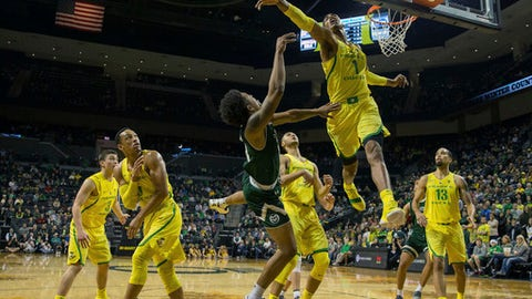 Oregon's Kenny Wooten (1) defends a shot by Colorado State's Prentiss Nixon under the basket during an NCAA college basketball game in Eugene, Ore., Friday, Dec. 8, 2017. (Brian Davies/The Register-Guard via AP)