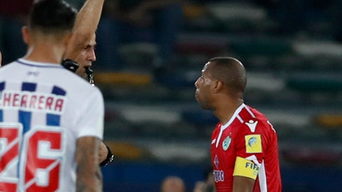 Referee Ravshan Irmatov shows a red card to Morocco's Wydad Athletic Club Brahim Nakach during the Club World Cup soccer match between Pachuca and Wydad Athletic Club at Zayed sport city in Abu Dhabi, United Arab Emirates, Saturday, Dec. 9, 2017. (AP Photo/Hassan Ammar)