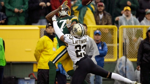 FILE - In this Oct. 22, 2017, file photo, New Orleans Saints cornerback Marshon Lattimore (23) breaks up a pass intended for Green Bay Packers wide receiver Davante Adams (17) during the first half of an NFL football game, in Green Bay, Wis. Rookies are contributing as much, or more, than ever in the NFL nowadays. With players such as Marshon Lattimore making an immediate impact, this season's first-year class ranks among the strongest since 2000. (AP Photo/Jeffrey Phelps, File)