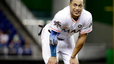 FILE - In this Aug. 14, 2017, file photo, Miami Marlins' Giancarlo Stanton stands on the field during a baseball game against the San Francisco Giants in Miami.  A person familiar with the negotiations says the New York Yankees and Miami Marlins are working on a trade that would send slugger Giancarlo Stanton to New York and infielder Starlin Castro to Miami.  The person spoke to The Associated Press on condition of anonymity Saturday, Dec. 9, 2017, because no agreement has been completed. (AP Photo/Lynne Sladky, File)