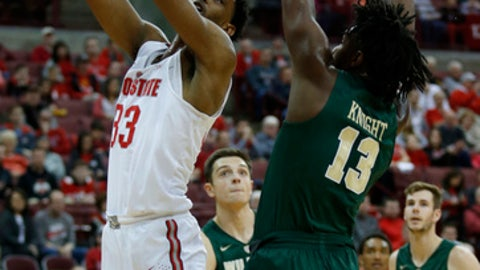 Ohio State forward Keita Bates-Diop, left, goes up for a shot against William & Mary forward Nathan Knight during the first half of an NCAA college basketball game in Columbus, Ohio, Saturday, Dec. 9, 2017. (AP Photo/Paul Vernon)