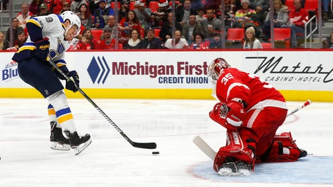 St. Louis Blues right wing Scottie Upshall (9) scores on Detroit Red Wings goalie Jimmy Howard (35) in the second period of an NHL hockey game Saturday, Dec. 9, 2017, in Detroit. (AP Photo/Paul Sancya)