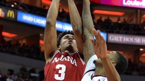 Indiana forward Justin Smith (3) shoots over the defense of Louisville forward Malik Williams (5) during the first half of an NCAA college basketball game, Saturday, Dec. 9, 2017, in Louisville, Ky. (AP Photo/Timothy D. Easley)