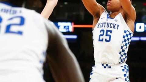 Kentucky forward PJ Washington (25) shoots past Monmouth defenders during an NCAA college basketball game at Madison Square Garden in New York, Saturday, Dec. 9, 2017. Kentucky defeated Monmouth 93-76. (Alex Slitz/Lexington Herald-Leader via AP)