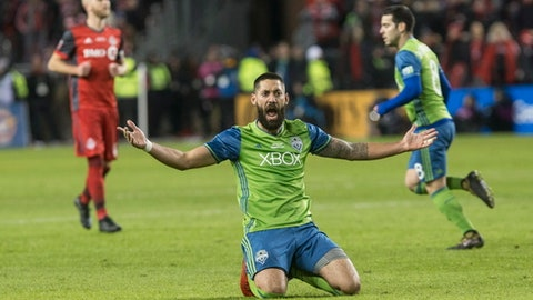 Seattle Sounders' Clint Dempsey appeals for a foul during first-half MLS Cup final soccer action against Toronto FC in Toronto, Saturday, Dec. 9, 2017. (Chris Young/The Canadian Press via AP)