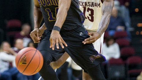 Texas A&M guard Duane Wilson (13) knocks the ball away from Prairie View A&M forward Zachary Hamilton during the second half of an NCAA college basketball game Saturday, Dec. 9, 2017, in College Station, Texas. (AP Photo/Sam Craft)