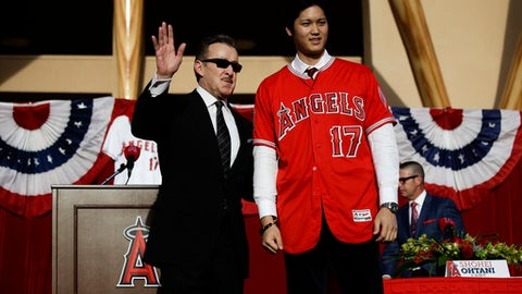 Japanese baseball player Shohei Ohtani, right, and Los Angeles Angeles Angels owner Arte Moreno pause for photos during a news conference Saturday, Dec. 9, 2017, in Anaheim, Calif. The Japanese star is bringing his arm and bat to the Angels, pairing him with two-time MVP Mike Trout. (AP Photo/Jae C. Hong)