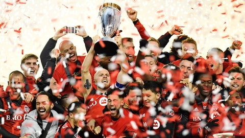 Toronto FC captain Michael Bradley hoists the trophy as the team celebrates its win over the Seattle Sounders in the MLS Cup final in Toronto, Saturday, Dec. 9, 2017. (Frank Gunn/The Canadian Press via AP)