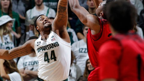 Michigan State's Nick Ward (44) blocks a shot by Southern Utah's Christian Musoko during the first half of an NCAA college basketball game Saturday, Dec. 9, 2017, in East Lansing, Mich. (AP Photo/Al Goldis)
