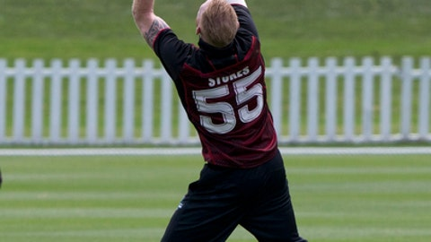 England cricketer Ben Stokes takes a catch to dismiss Northern Districts batsman Anton Devich during his match for Canterbury against Northern Districts in Christchurch, New Zealand, Sunday, Dec. 10, 2017.The New Zealand-born allrounder has been suspended from playing for England while police investigate his role in the September 25 incident in Bristol which followed a limited-overs international against the West Indies. (AP Photo/Mark Baker)