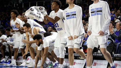 Middle Tennessee players celebrate after a score in the second half of an NCAA college basketball game against Mississippi Saturday, Dec. 9, 2017, in Murfreesboro, Tenn. Middle Tennessee won 77-58. (AP Photo/Mark Humphrey)