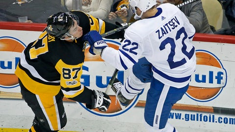 Pittsburgh Penguins' Sidney Crosby (87) collides with Toronto Maple Leafs' Nikita Zaitsev (22) during the first period of an NHL hockey game in Pittsburgh, Saturday, Dec. 9, 2017. (AP Photo/Gene J. Puskar)