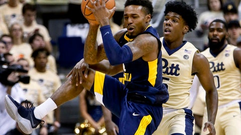 West Virginia's Daxter Miles Jr., left, catches a pass as Pittsburgh's Kene Chukwuka defends during the first half of an NCAA college basketball game Saturday, Dec. 9, 2017, in Pittsburgh. (AP Photo/Keith Srakocic)