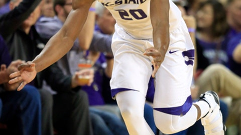 Kansas State forward Xavier Sneed (20) celebrates a three-point basket during the first half of an NCAA college basketball game against Tulsa in Wichita, Kan., Saturday, Dec. 9, 2017. (AP Photo/Orlin Wagner)