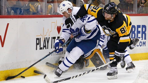 Pittsburgh Penguins' Phil Kessel (81) battles Toronto Maple Leafs' Roman Polak (46) for the puck in the second period of an NHL hockey game in Pittsburgh, Saturday, Dec. 9, 2017. (AP Photo/Gene J. Puskar)