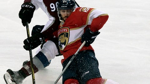 Florida Panthers' Vincent Trocheck , front, and Colorado Avalanche's Mikko Rantanen, back, of Finland, battle for the puck during the third period of an NHL hockey game, Saturday, Dec. 9, 2017, in Sunrise, Fla. (AP Photo/Luis M. Alvarez)