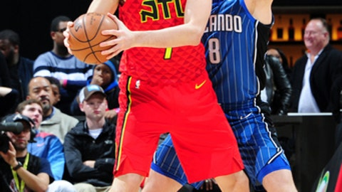 ATLANTA, GA - DECEMBER 9: Ersan Ilyasova #7 of the Atlanta Hawks handles the ball against the Orlando Magic on December 9, 2017 at Philips Arena in Atlanta, Georgia. NOTE TO USER: User expressly acknowledges and agrees that, by downloading and/or using this photograph, user is consenting to the terms and conditions of the Getty Images License Agreement. Mandatory Copyright Notice: Copyright 2017 NBAE (Photo by Scott Cunningham/NBAE via Getty Images)