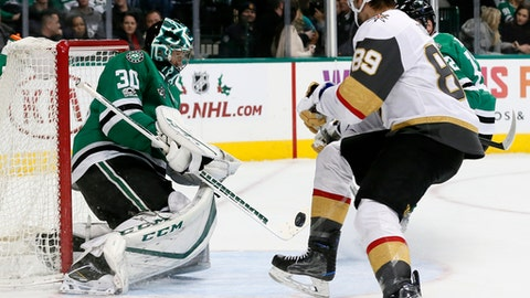 Dallas Stars goalie Ben Bishop (30) blocks a shot as Vegas Golden Knights right wing Alex Tuch (89) looks for a rebound during the second period of an NHL hockey game Saturday, Dec. 9, 2017, in Dallas. (AP Photo/Tony Gutierrez)