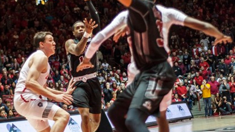 Lofton scores 22 as New Mexico State beats New Mexico 65-62