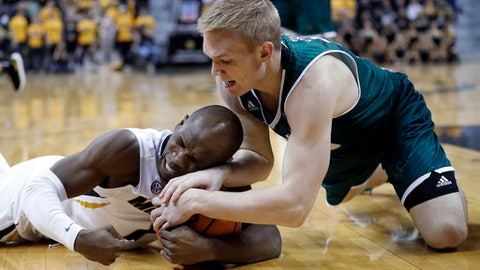 Green Bay's Hunter Crist, right, and Missouri's Terrence Phillips dive after a loose ball during the second half of an NCAA college basketball game Saturday, Dec. 9, 2017, in Columbia, Mo. (AP Photo/Jeff Roberson)