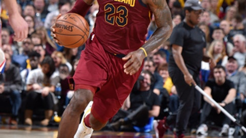 CLEVELAND, OH - DECEMBER 9:  LeBron James #23 of the Cleveland Cavaliers handles the ball against the Philadelphia 76ers on December 9, 2017 at Quicken Loans Arena in Cleveland, Ohio. NOTE TO USER: User expressly acknowledges and agrees that, by downloading and/or using this Photograph, user is consenting to the terms and conditions of the Getty Images License Agreement. Mandatory Copyright Notice: Copyright 2017 NBAE  (Photo by David Liam Kyle/NBAE via Getty Images)