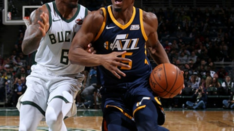 MILWAUKEE, WI - DECEMBER 9: Donovan Mitchell #45 of the Utah Jazz handles the ball against the Milwaukee Bucks on December 9, 2017 at the BMO Harris Bradley Center in Milwaukee, Wisconsin. NOTE TO USER: User expressly acknowledges and agrees that, by downloading and or using this Photograph, user is consenting to the terms and conditions of the Getty Images License Agreement. Mandatory Copyright Notice: Copyright 2017 NBAE (Photo by Gary Dineen/NBAE via Getty Images)