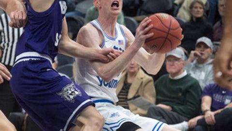 BYU guard TJ Haws (30) looks for a shot against Weber State in an NCAA college basketball game in the Beehive Classic in Salt Lake City, Utah, Saturday, Dec. 9, 2017. (Rick Egan/The Salt Lake Tribune via AP)