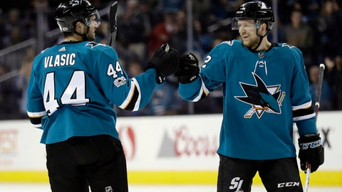 San Jose Sharks defenseman Marc-Edouard Vlasic (44) celebrates his goal with teammate Tim Heed during the second period of an NHL hockey game against the Ottawa Senators on Saturday, Dec. 9, 2017, in San Jose, Calif. (AP Photo/Marcio Jose Sanchez)