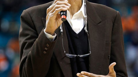 Retired NBA basketball player Kareem Abdul-Jabbar speaks during halftime of an NCAA college basketball game between UNLV and Illinois, Saturday, Dec. 9, 2017, in Las Vegas. (AP Photo/John Locher)