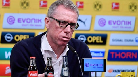 Austrian coach Peter Stoeger talks to the media at a press conference of Borussia Dortmund, where he is presented as the new head coach of the Bundesliga soccer club in Dortmund, Germany, Sunday, Dec. 10, 2017. Borussia Dortmund displaced Dutch head coach Peter Bosz Saturday after a defeat against Werder Bremen. Stoeger was dismissed as head coach of FC Cologne earlier this month. (AP Photo/Martin Meissner)
